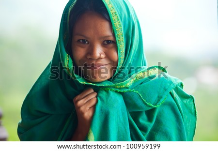 Portrait of south-east asian looking young woman - stock photo