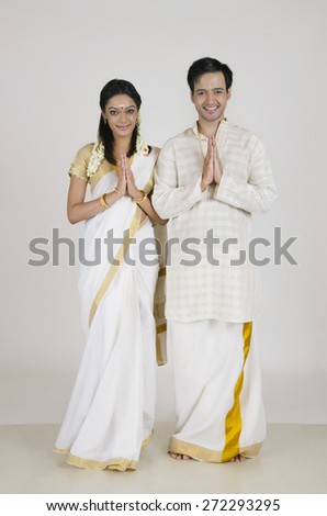 Portrait of South Indian couple greeting - stock photo