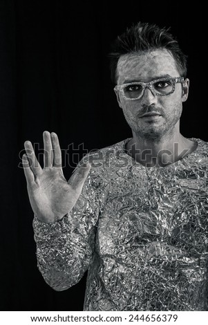 Portrait of spaceman greeting. - stock photo