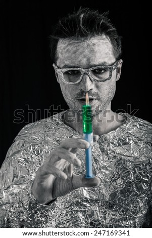 Portrait of spaceman with syringe. - stock photo