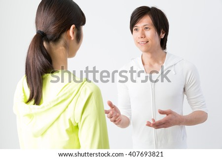 portrait of sporty asian people talking on white background - stock photo