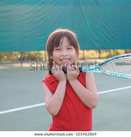 Portrait of sporty beautiful asian girl tennis player - stock photo