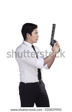 Portrait of srcret agent holding a gun isolated over a white background - stock photo