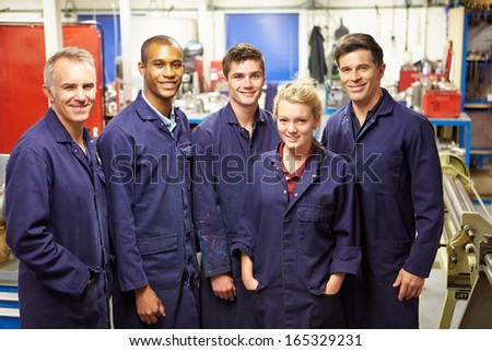 Portrait Of Staff Standing In Engineering Factory - stock photo