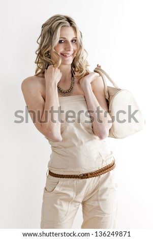 portrait of standing woman wearing summer clothes - stock photo