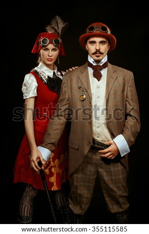 portrait of steampunk girl and man in glasses and cane - stock photo