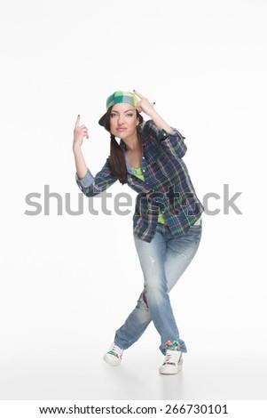 Portrait of street dancer in cap on white background - stock photo