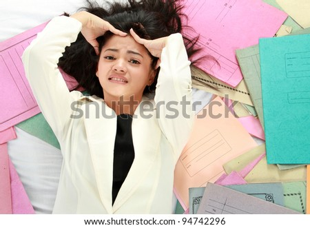 Portrait of stress business woman with document around her - stock photo