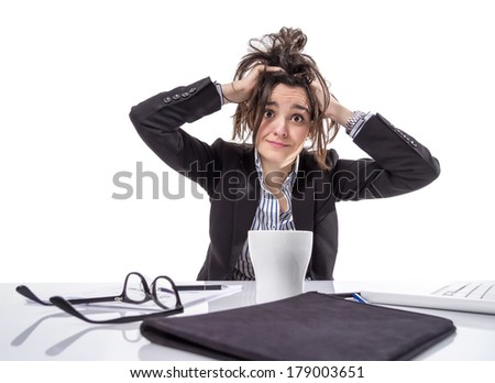 Portrait of stressed and frustrated young business woman pulling her hair over white background - stock photo