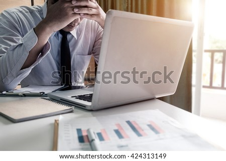 portrait of stressed business man and graph business with social network diagram and man working in the office.  - stock photo
