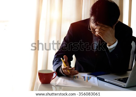 portrait of stressed business man in the office. - stock photo