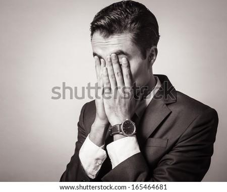 Portrait of stressed businessman - stock photo