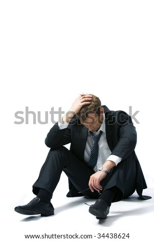 Portrait of stressed businessman touching his head and thinking about future - stock photo