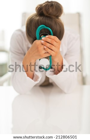 Portrait of stressed doctor woman - stock photo