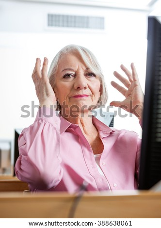 Portrait Of Stressed Senior Woman In Computer Class - stock photo