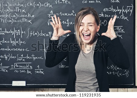 portrait of stressed teacher and blackboard background - stock photo