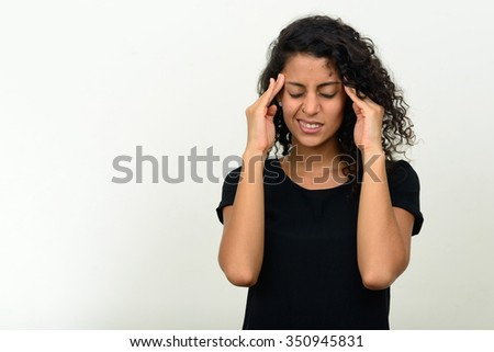 Portrait of stressed young Brazilian woman having headache