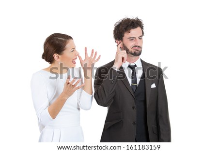 Portrait of stressed young couple going through hard times in their relationship, isolated on a white background . Wife, girlfriend trying to explain something to man, he is annoyed and closes ears. - stock photo