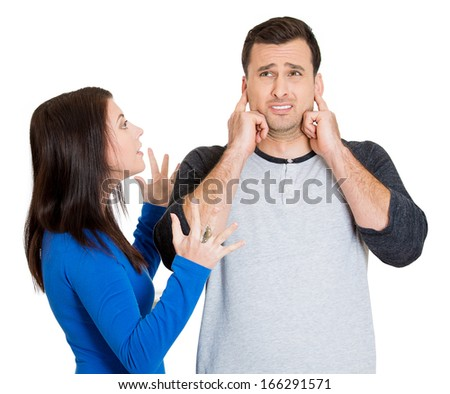 Portrait of stressed young couple going through relationship hard times, isolated on white background. Upset angry sister, wife, girlfriend trying to explain something to annoyed man who closes ears. - stock photo