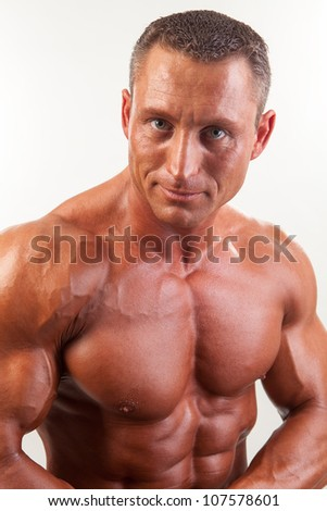 Portrait of strong handsome man on white - studio shot - stock photo