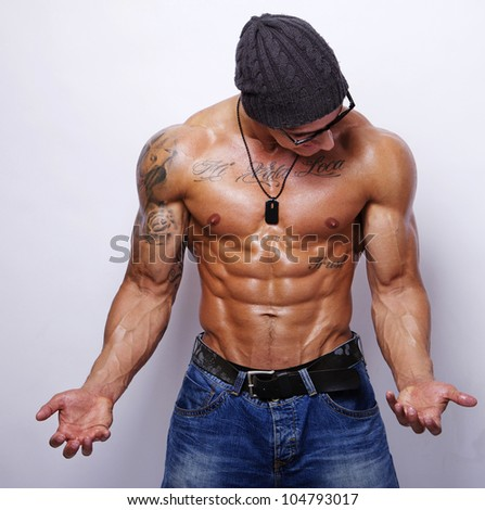 Portrait of strong man posing in studio