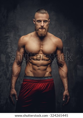 Portrait of strong muscular guy with beard. - stock photo