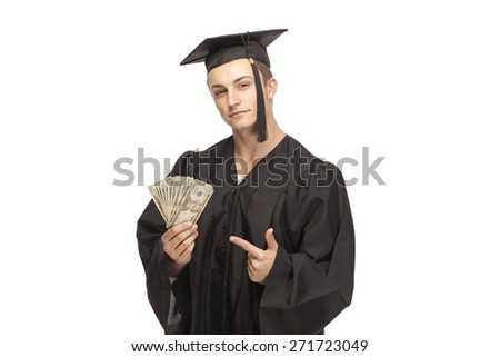 Portrait of student in graduation gown showing money against white background - stock photo