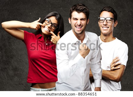 portrait of student´s group smiling and joking against a grunge background