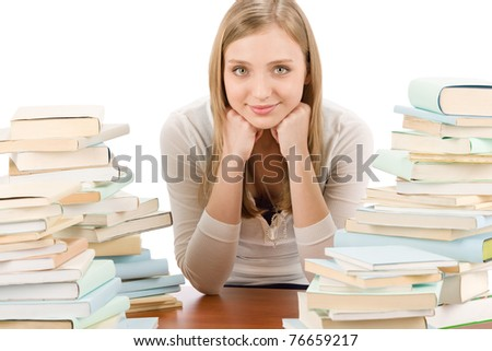 Portrait of student teenager woman with piles of books - stock photo