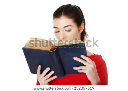 Portrait of student woman reading a book. - stock photo