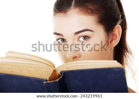 Portrait of student woman reading a book.