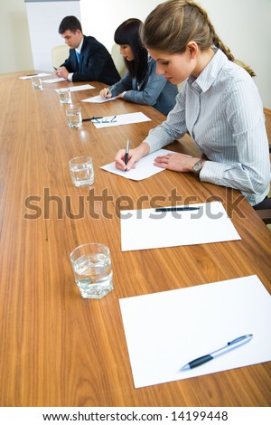 Portrait of student writing a lecture at business seminar - stock photo