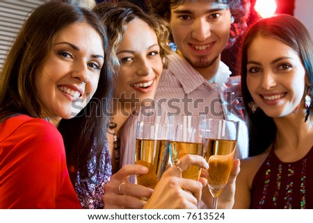 Portrait of students holding the glasses making a toast - stock photo