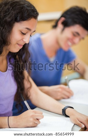 Portrait of students writing in an amphitheater - stock photo
