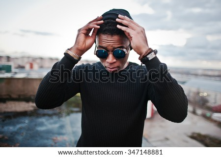 Portrait of  style black man on the roof - stock photo