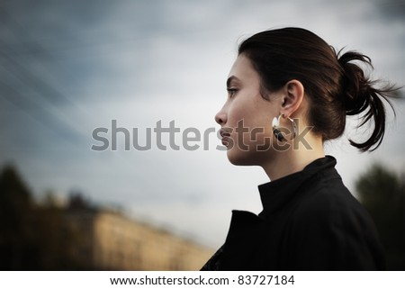 Portrait of stylish Asian woman in city, closeup. - stock photo