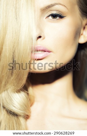 Portrait of stylish attractive lady with silk blonde hair and tender makeup closeup, vertical picture - stock photo