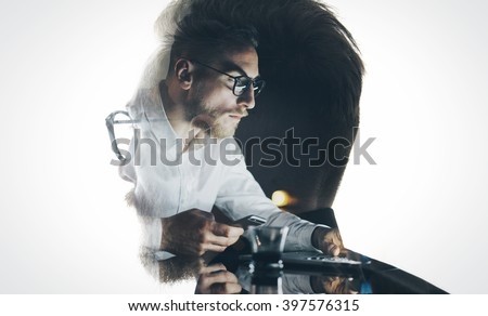 Portrait of stylish bearded lawyer wearing glasses and looking city. Double exposure, businessman working laptop at night, texting smartphone background. Isolated white. Horizontal - stock photo