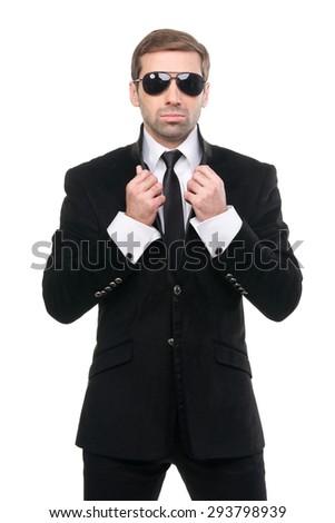 Portrait of stylish bodyguard with sunglasses. Isolated over white background - stock photo