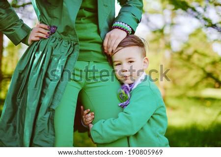 Portrait of stylish boy hugs his mother - stock photo