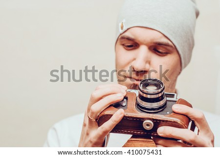 portrait of stylish handsome man with old fashioned camera - stock photo