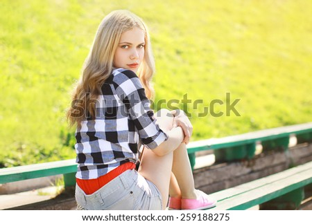 Portrait of stylish pretty blonde outdoors in sunny summer day - stock photo