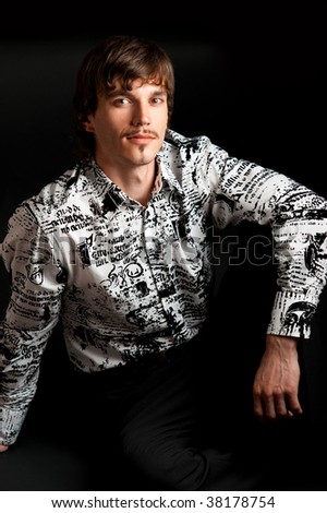 Portrait of stylish young adult looking at camera against black background - stock photo