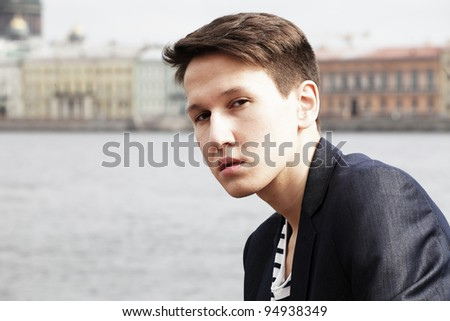 Portrait of stylish young man wearing casual outdoors - stock photo