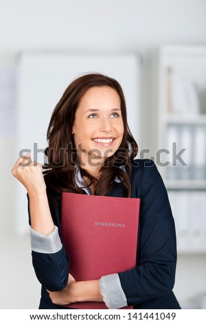 Portrait of successful applicant holding her document files - stock photo