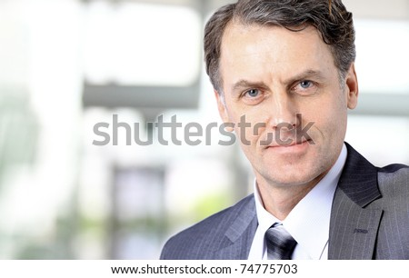 Portrait of successful business man - stock photo