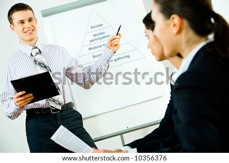 Portrait of successful business man teaching a lecture in the conference room - stock photo