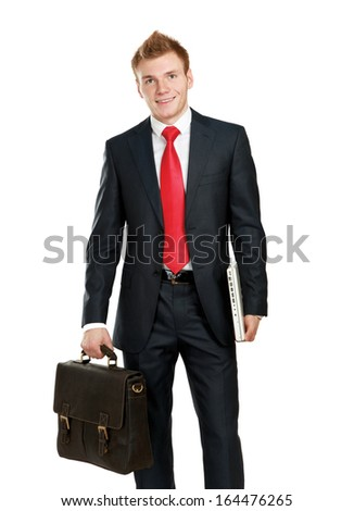 Portrait of successful business man with bag - stock photo