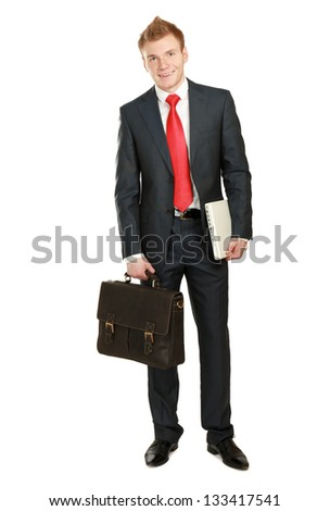 Portrait of successful business man with bag and holding laptop, isolated on white background