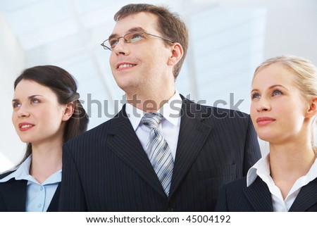 Portrait of successful business partners looking forwards with smiles - stock photo